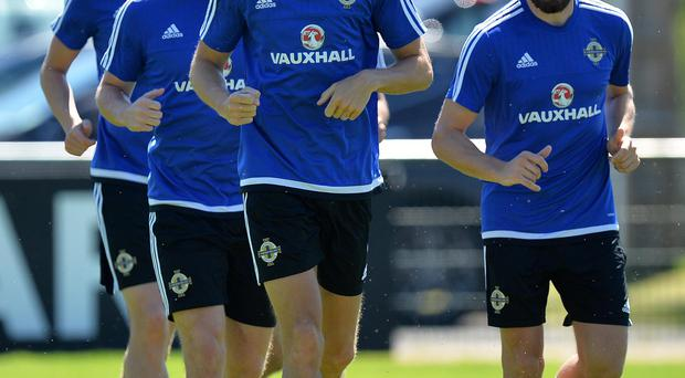 Striding forward: Jonny Evans and Northern Ireland are back in training