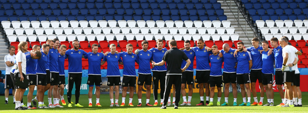 Band of brothers: Michael O'Neill talks to his team at the Parc des Princes ahead of their game against Wales
