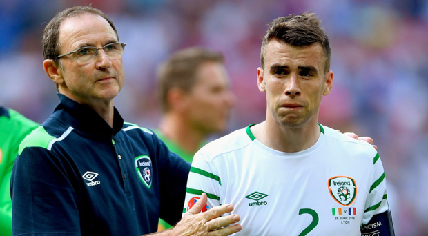 Tearful goodbye: Martin O'Neill consoles Seamus Coleman after the Republic of Ireland exited Euro 2016