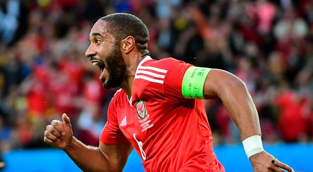 Get in: Wales' Ashley Williams celebrates his equaliser last night