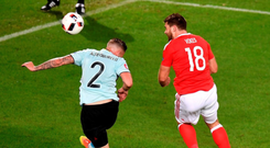 Welsh wonder: Sam Vokes of Wales beats Toby Alderweireld of Belgium to score their third goal and seal an historic victory against Belgium