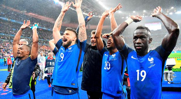 Blue heaven: French players celebrate their victory over Iceland