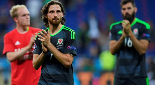 Applause all round: Joe Allen hails the crowd after Wales' semi-final defeat