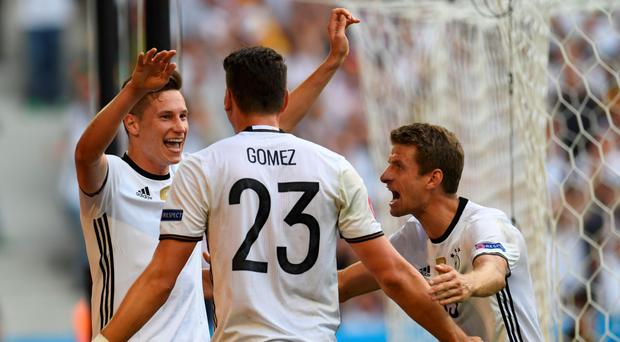 Julian Draxler celebrates with Mario Gomez and Thomas Muller at the Euros.