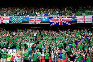 Northern Ireland fans show their support in the stands during the UEFA Euro 2016, Group C match at the Parc Des Princes, Paris.  Jonathan Brady/PA Wire.