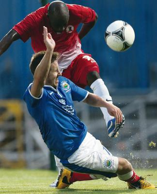 Linfield's Michael Carvill with FC Xanthi's Serge Die during Thursday nights Europa League 2nd Qualifying Round, 2nd leg game at Windsor Park.
