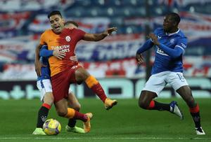 Shining star: Glen Kamara gets into the thick of the action during the Europa League play-off against Galatasaray