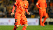 Struck down: Lionel Messi before being hit by a bottle