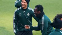 MANCHESTER, ENGLAND - MARCH 04:  Cristiano Ronaldo of Real Madrid shares a joke with Michael Essien during a training session at Etihad Stadium on March 4, 2013 in Manchester, England.  (Photo by Alex Livesey/Getty Images)