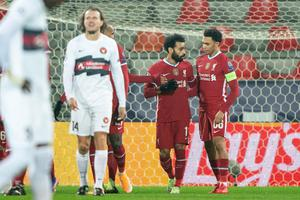 Record-breaker: Mo Salah is congratulated after scoring his 22nd and Liverpool's fastest Champions League goal