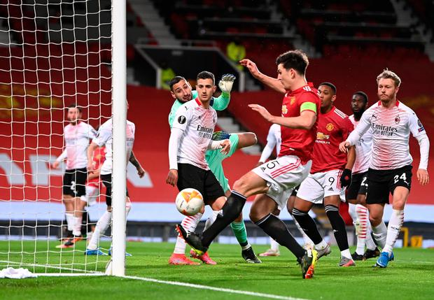 Big miss: Manchester United captain Harry Maguire somehow manages to hit the post rather than tap the ball into the net