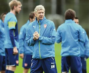 Deep in thought: Arsenal manager Arsene Wenger conducts a  training session at London Colney yesterday