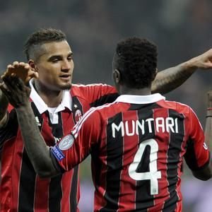 MILAN, ITALY - FEBRUARY 20: Kevin Prince Boateng and Sulley Muntari of AC Milan celebrate victory at the end of the UEFA Champions League Round of 16 first leg match between AC Milan and Barcelona at San Siro Stadium on February 20, 2013 in Milan, Italy. (Photo by Claudio Villa/Getty Images)