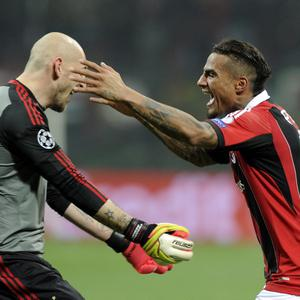 MILAN, ITALY - FEBRUARY 20: Kevin Prince Boateng and Cristian Abbiati (L) of AC Milan celebrate victory at the end of the UEFA Champions League Round of 16 first leg match between AC Milan and Barcelona at San Siro Stadium on February 20, 2013 in Milan, Italy. (Photo by Claudio Villa/Getty Images)