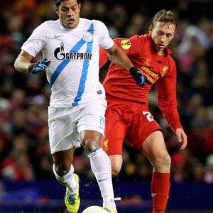 LIVERPOOL, ENGLAND - FEBRUARY 21: Hulk of Zenit is challenged by Lucas of Liverpool during the UEFA Europa League round of 32 second leg match between Liverpool FC and FC Zenit St Petersburg at Anfield on February 21, 2013 in Liverpool, England. (Photo by Alex Livesey/Getty Images)