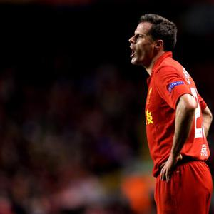 LIVERPOOL, ENGLAND - FEBRUARY 21: Jamie Carragher of Liverpool reacts during the UEFA Europa League round of 32 second leg match between Liverpool FC and FC Zenit St Petersburg at Anfield on February 21, 2013 in Liverpool, England. (Photo by Alex Livesey/Getty Images)