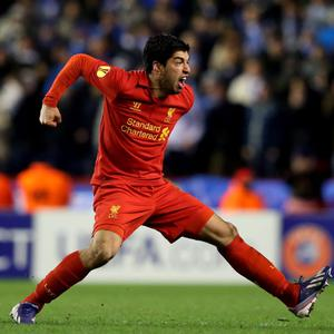 LIVERPOOL, ENGLAND - FEBRUARY 21: Luis Suarez of Liverpool celebrates after scoring his team's third goal from a free kick during the UEFA Europa League round of 32 second leg match between Liverpool FC and FC Zenit St Petersburg at Anfield on February 21, 2013 in Liverpool, England. (Photo by Alex Livesey/Getty Images)