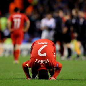 LIVERPOOL, ENGLAND - FEBRUARY 21: A dejected Luis Suarez of Liverpool reacts as his team win on the night but exit the competition during the UEFA Europa League round of 32 second leg match between Liverpool FC and FC Zenit St Petersburg at Anfield on February 21, 2013 in Liverpool, England. (Photo by Alex Livesey/Getty Images)
