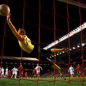 LIVERPOOL, ENGLAND - FEBRUARY 21: Goalkeeper Vyacheslav Malafeev of Zenit dives in vain as Luis Suarez of Liverpool scores a goal from a second half free kick during the UEFA Europa League round of 32 second leg match between Liverpool FC and FC Zenit St Petersburg at Anfield on February 21, 2013 in Liverpool, England. (Photo by Alex Livesey/Getty Images)