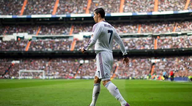 MADRID, SPAIN - MARCH 02: Cristiano Ronaldo of Real Madrid prepares to take a free kick during the la Liga match between Real Madrid CF and FC Barcelona at Estadio Santiago Bernabeu on March 2, 2013 in Madrid, Spain. (Photo by Jasper Juinen/Getty Images)