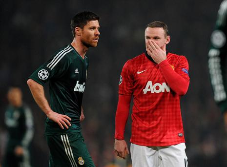 Manchester United's Wayne Rooney (right) and Real Madrid's Xabi Alonso during the UEFA Champions League match at Old Trafford, Manchester