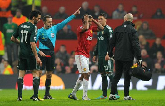 Manchester United's Nani is sent off after receiving a red card from referee Cuneyt Cakir during the UEFA Champions League match at Old Trafford, Manchester