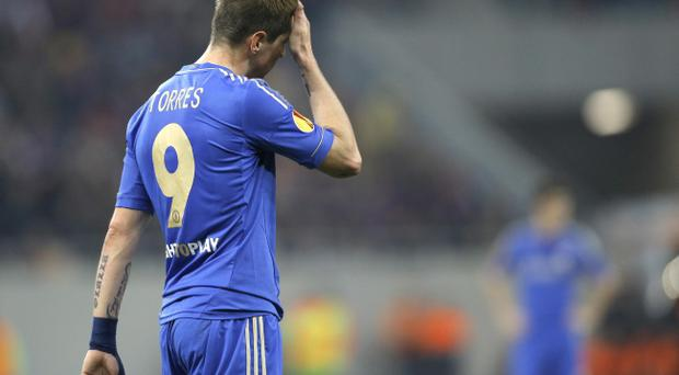 Chelsea's Fernando Torres, reacts after missing an opportunity to score against Steaua Bucharest during their Europa League round of 16 first leg soccer match at the National Arena stadium in Bucharest, Romania, Thursday, March 7, 2013. (AP Photo/Vadim Ghirda)