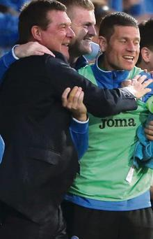 St Johnstones manager Tommy Wright celebrates at full time after the UEFA Europa League, second round, second leg match at McDiarmid Park, Perth.