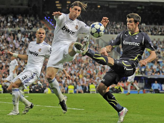 Tottenham's Gareth Bale (right) and Sergio Ramos, of Real Madrid, battle for possession at the Bernabeu in 2011