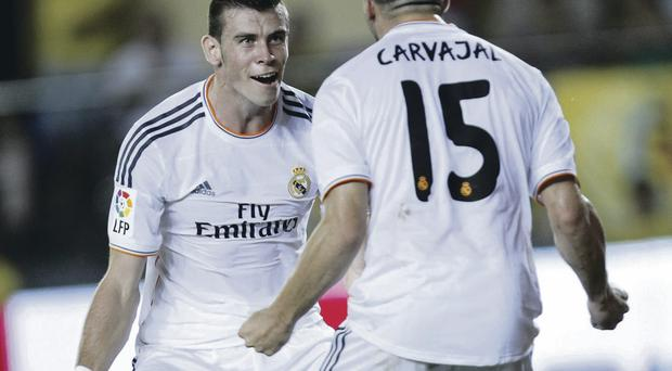 Take off: Gareth Bale celebrates after scoring his first goal for Real Madrid, 39 minutes into his debut, but the game against newly promoted Villarreal ended in a 2-2 draw