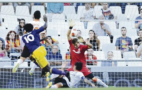 Polished finish: Wilfried Bony hammers home Swansea's opening goal in their Europa League victory against Valencia