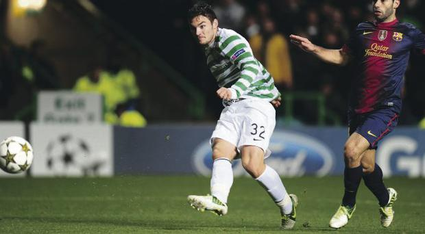 Perfect strike: Tony Watt scores the winner for Celtic as Barcelona's Javier Mascherano can only look on