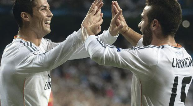 Class act: Real Madrid's Cristiano Ronaldo (left) celebrates with Daniel Carvajal after scoring first of his brace against Copenhagen