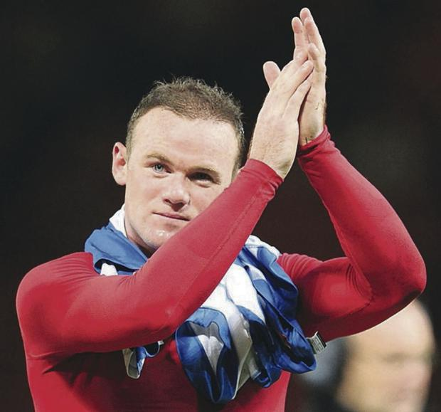 Manchester United's Wayne Rooney acknowledges the fans after the final whistle of the UEFA Champions League Group A match against Real Sociedad at Old Trafford, Manchester