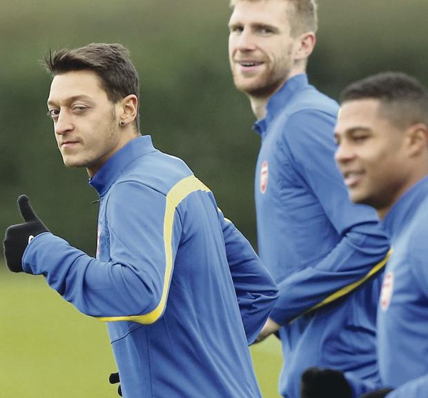 Arsenal's Mesut Ozil and fellow German ace Per Mertesacker in training ahead of tonight's game