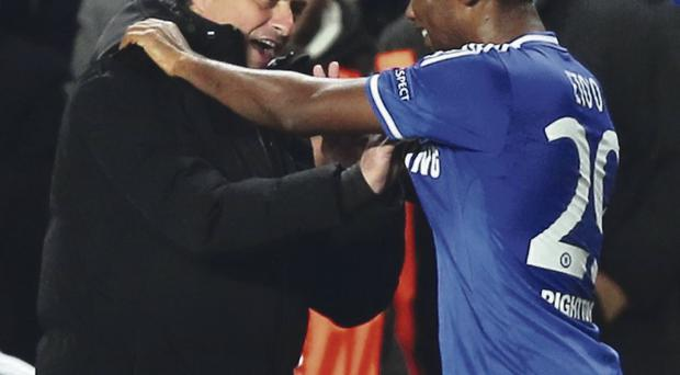 Double act: Samuel Eto'o and Jose Mourinho celebrate Chelsea's first goal in their victory over Schalke at Stamford Bridge