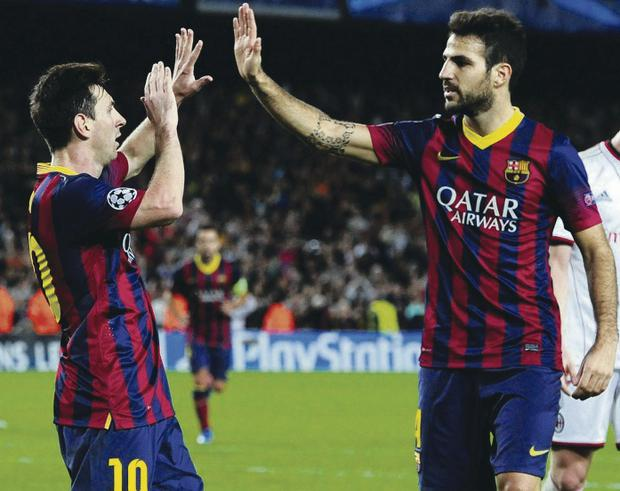 Get in: Barcelona scorer Lionel Messi celebrates with Cesc Fabregas