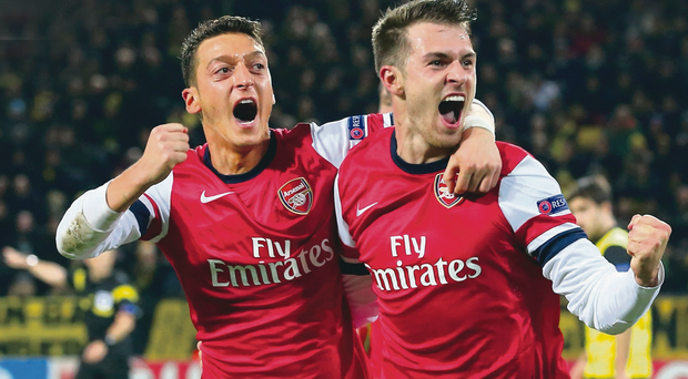 Get in: Aaron Ramsey celebrates scoring Arsenal's goal with Mesut Ozil