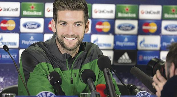 Smile for the camera: Celtic's Charlie Mulgrew is pictured at the pre-match press conference ahead of facing AC Milan