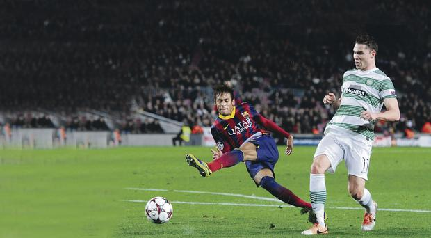 Neymar of FC Barcelona shoots towards goal under a challenge by Derk Boerrigter of Celtic FC during the Champions League Group H match between FC Barcelona and Celtic FC at Camp Nou on December 11, 2013 in Barcelona, Spain