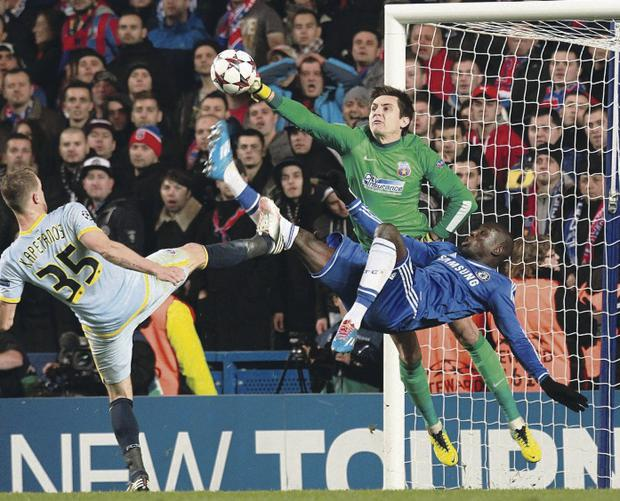 So close: Chelsea's Demba Ba (right) has a shot stopped by Steaua Bucurest goalkeeper Ciprian Tatarusanu