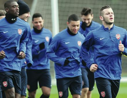 Gearing up: Jack Wilshere (far right) trains for this evening's clash