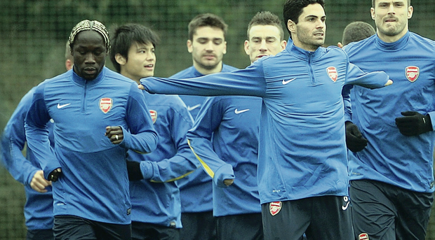 Arsenal, led by Mikel Arteta and Olivier Giroud, prepare for tonight's difficult task