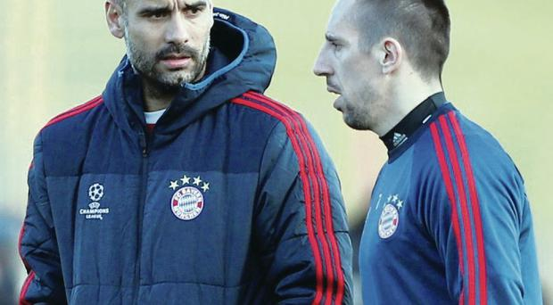 Bayern head coach Pep Guardiola talks to Franck Ribery in training yesterday ahead of the Gunners clash
