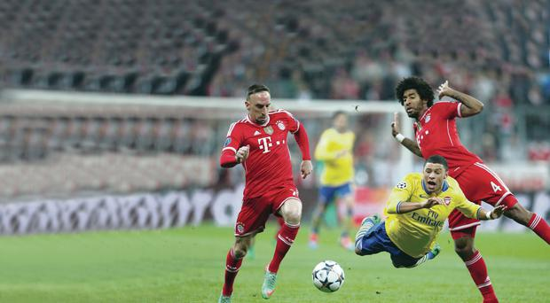 Ground force: Alex Oxlade-Chamberlain is upended by Bayern defence last night