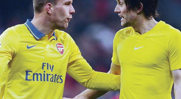 At loggerheads: Lukas Podolski (left) remonstrates with Tomas Rosicky after the final whistle at the Allianz Arena last night