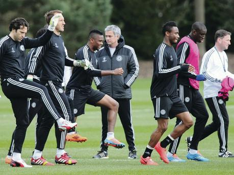 Angry: Chelsea boss Jose Mourinho watches his players in training ahead of facing Galatasary in the Champions League