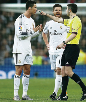 Not happy: Ronaldo argues with referee Alberto Undiano during Sunday's El Clasico
