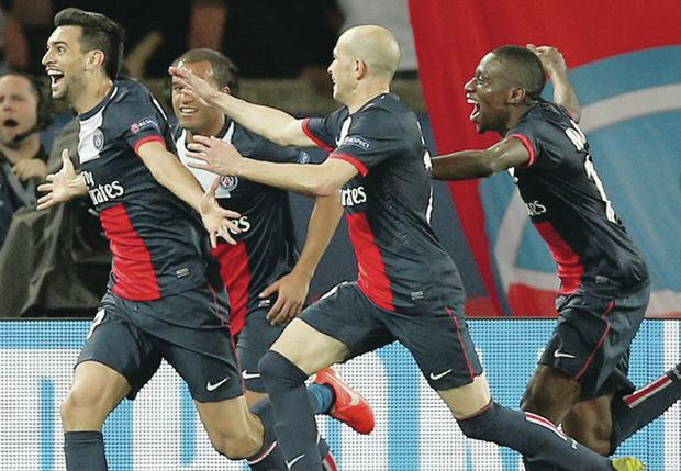 Javier Pastore, left, celebrates after scoring his side's third goal in the convincing first leg victory