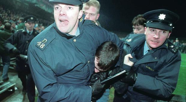 Unhappy ending: shameful scenes like this led to England's last visit to Dublin being abandoned after just 25 minutes